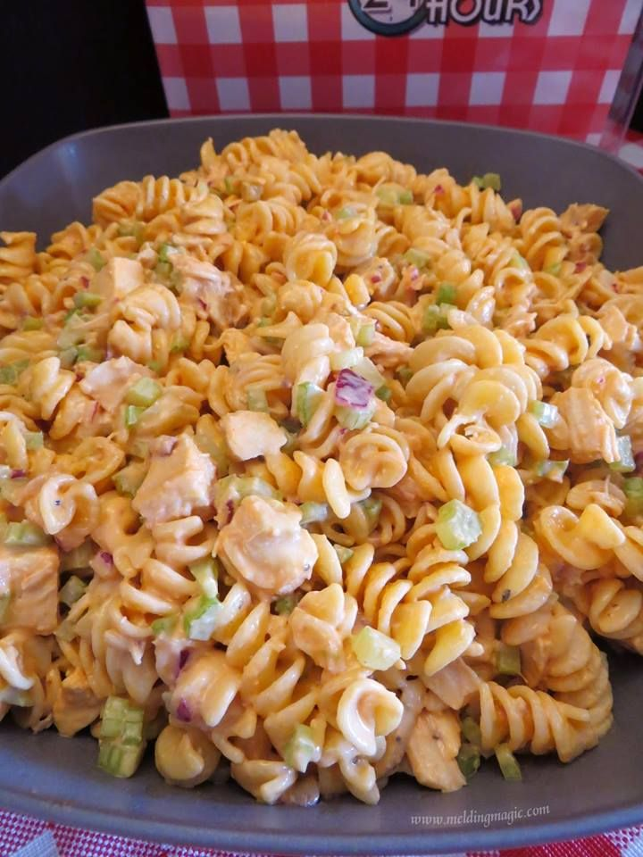 BUFFALO CHICKEN PASTA SALAD 16 oz Rotini 12 oz Rootie's Blue Cheese or Ranch Dressing 1 to 1-1/4 cups Franks' Hot sauce 2 to 3 cooked chicken breasts 5 to 6 stalks celery, chopped 1/2 to 1 whole red onion, chopped  1. Cook pasta according to package directions. Rinse w/ cold water and drain  2. Combine dressing & hot sauce. Start with 3/4 to 1 cup of hot sauce, then adjust to taste. 3. Combine pasta, dressing mixture, celery, onions and diced chicken. Mix, add seasoning. Cover and chill