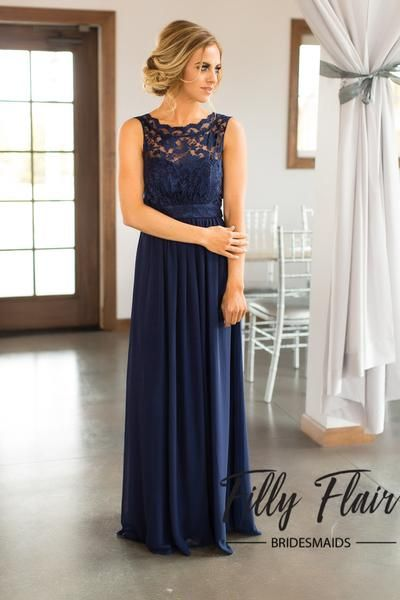 Beautiful lace details set this dress apart from any other affordable bridesmaid dresses! This beautiful full length dress features a sheer lace overlay covering it's front and back and long layers of sheer chiffon, giving it a classic and elegant look. This classic navy bridesmaid dress will be the perfect addition to your dream wedding!  100% PolyesterLining 100% PolyesterProfessionally Spot CleanFIT: This garment runs true to size. BUST: Great for any cup size. WAIST: Fitted, some s...
