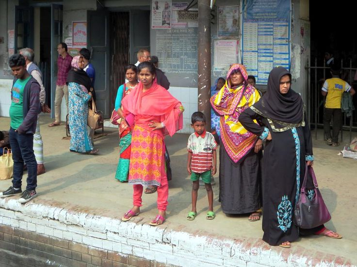 Impatient passengers awaiting their train on a railway platform between Rajshahi and Khulna, Bangladesh.
