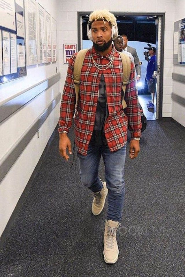 Odell Beckham Jr. wearing  Amiri Stack Jean Med Indigo, Fear of God Military…