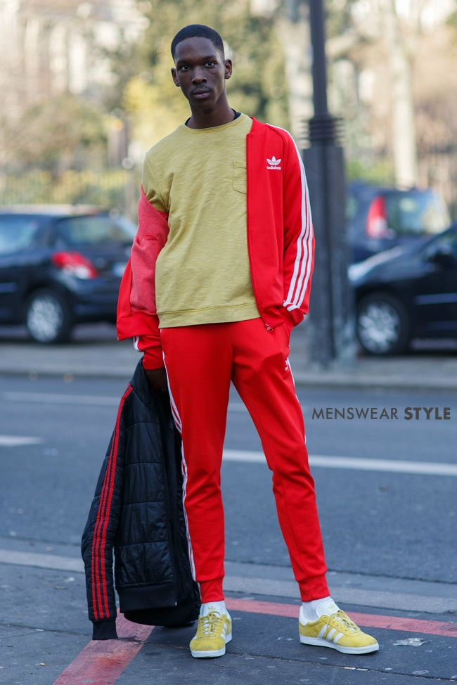 A classic urban sports style outfit featuring a red adidas tracksuit  spotted on the streets of