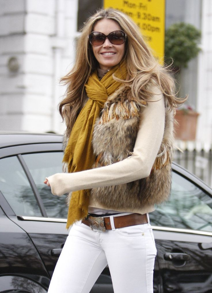 Photo 1223278 - Elle Mcpherson dropping off her children at school fur vest mustard scarf sunglasses - Posh24