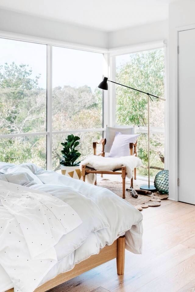 White bedding and a solid wood bed for a stylish modern bedroom (those windows don't hurt either!!!) For similar bedding and modern, solid wood beds try: www.naturalbedcompany.co.uk