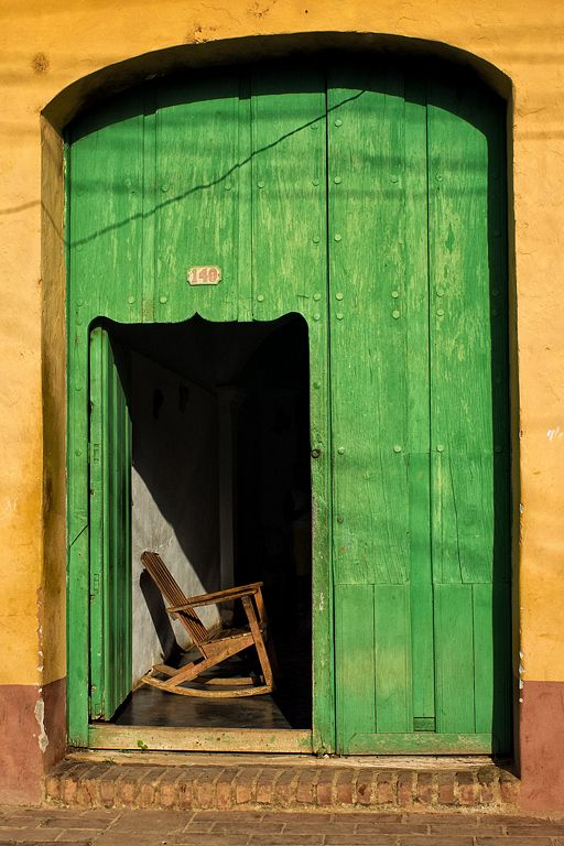 This is a cute door!! I can just see an old man with his cigar swaying back and forth on this chair!