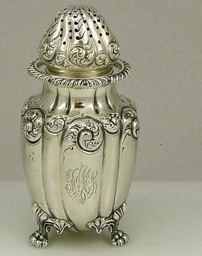 An antique sterling silver sugar shaker by Howard and Co of New York dated 1895.