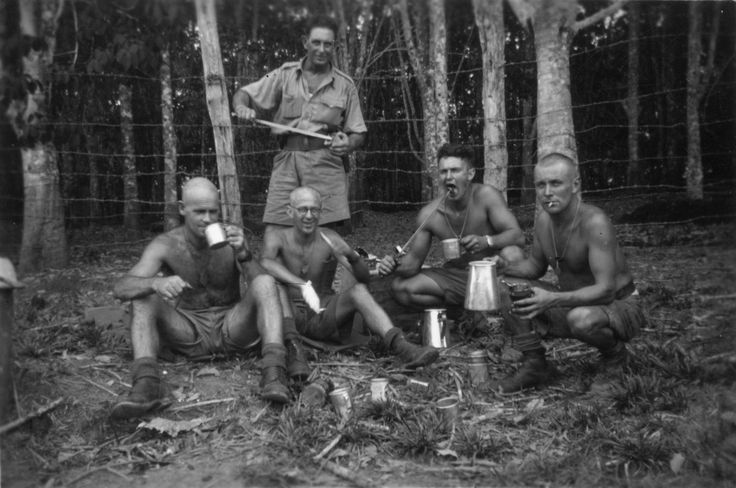 Men of No.1 Aerodrome Construction Squadron having a snack by the roadside, Malaysia, December 1941. From the collection of the air Force Museum of New Zealand.