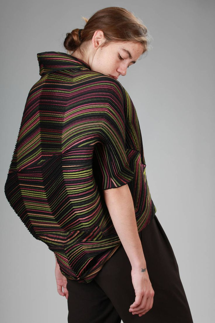 Issey Miyake | wide jacket in narrow wave steam-stretch pleated polyester with a multicolour optical effect |