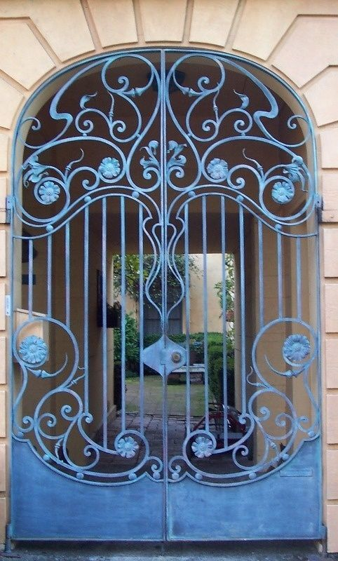 Art Nouveau Wrought Iron Door. I would actually like this indoors--like the entrance to a kitchen or formal dining room.