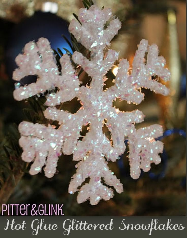Gorgeous Hot Glue Glitter Snowflake  Again, I made these for a craft class and they were a HUGE hit.  Big tip to make them even more beautiful - after the initial layer of hot glue has dried, apply an additional layer on top. Allow to dry, and then continue following directions.