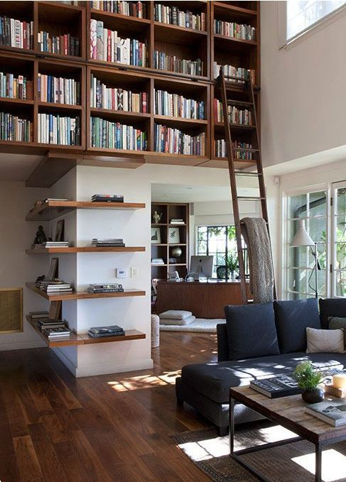 Decorating tip: Do you have high ceilings? Fill the space with books to create coziness.