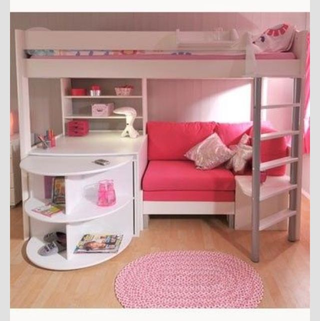 What a fun little bed/study/nook design. Looks like the rounded shelves are part of a piece that pulls out a couple feet further to reveal a desk with knee hole. I'd go for more pizzazz with color choices though. I have nothing against pink, but pink and white is BORING. How 'bout a soft purple with bright lime green?