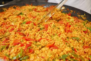 Vegan paella with green peas, artichokes and bell pepper photo by Fuse / Getty Images - Vegan paella with green peas, artichokes and bell peppers. *Could add some Field Roast Chorizo too!*