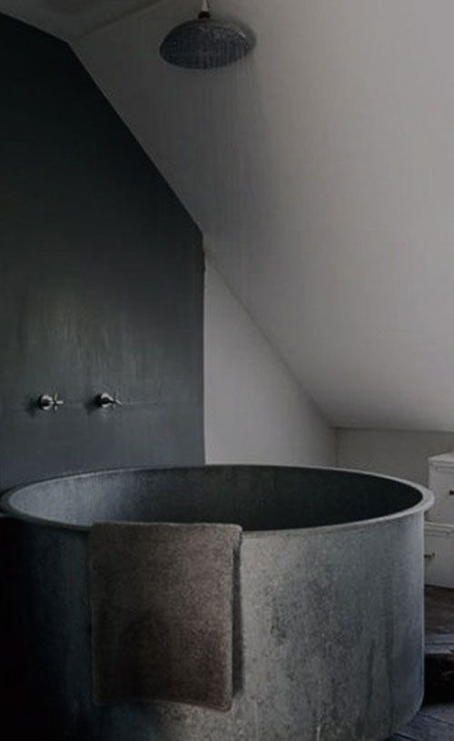 I am in love with this black metal bathub and shower! This grey bathroom is gorgeous!