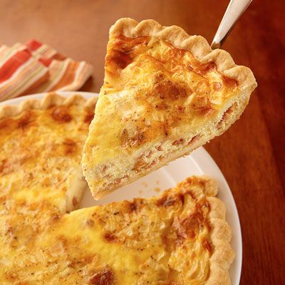 A classic savory quiche filled with onions, bacon and Swiss cheese.