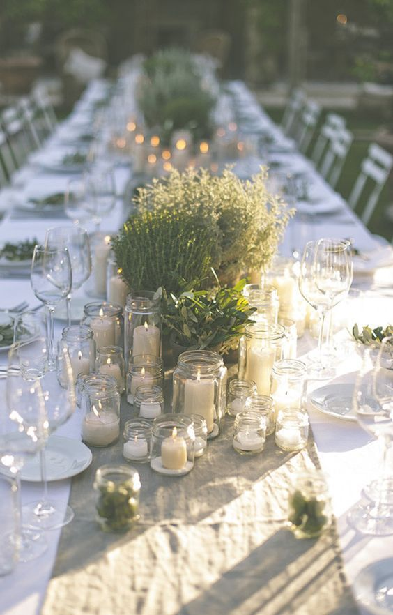 simple potted plants and greenery with lots of candles can comprise great center…