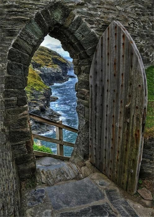"Gate to the sea - Tintagel, U.K. ""Tintagel or Trevena is a civil parish and village situated on the Atlantic coast of Cornwall, England. The village and nearby Tintagel Castle are associated with the legends surrounding King Arthur and the knights of the Round Table. The village has, in recent times, become attractive to tourists and day-trippers from many parts of the world and is one of the most-visited places in Britain."""