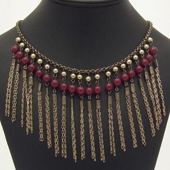 Ne mettre qu'un seul rang de perles. Remplacer les chaines par un fil clouté? ou lien en cuir? ou plumes?