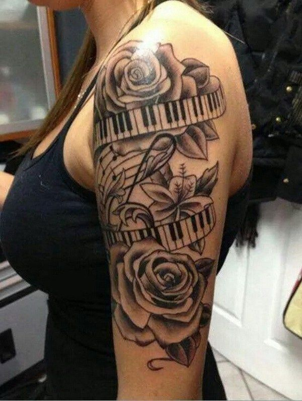 Beautiful Flowers with Piano Ribbon and Music Notes Tattoo.