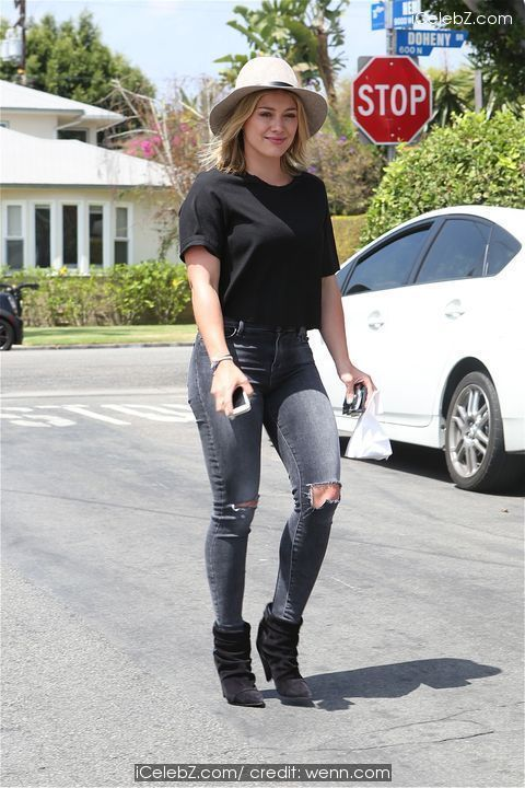 Hilary Duff Leaving La Conversation Cafe in West Hollywood wearing a wide brimmed hat ripped jeans and black top and pixie boots http://icelebz.com/events/hilary_duff_leaving_la_conversation_cafe_in_west_hollywood_wearing_a_wide_brimmed_hat_ripped_jeans_and_black_top_and_pixie_boots/photo2.html