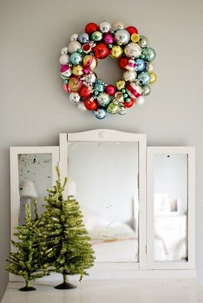 Simple yet so colorful! Vintage ornament wreath and understated trees.
