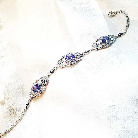 Tanzanite Bracelet In Platinum, Handmade Jewelry, Instant Bridal Heirloom By NorthCoastCottage Jewelry Design & Vintage Treasures. Beautifully matched tanzanite ovals are here set in an intricately detailed, ornate setting made of platinum over sterling silver. For the bride, this