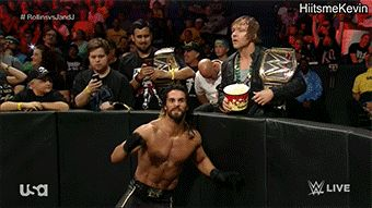 Dean's Like... HAVE SOME POPCORN YOU HALF BLONDE BITCH... THIS IS WHY I LOVE DEAN AMBROSE<3<3<3<3
