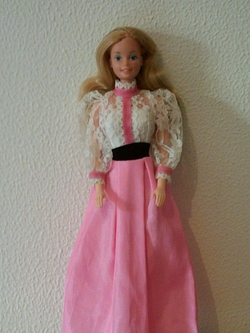 Had this one, the dress is in ok shape. Most of the dresses made then had the same shape/style... My 3yr Goddaughter see the dresses & says... 'ahh No'. ++Plus the dresses made in the 80-90's do Not Fit TODAYS BARBIES. Yes Barbie has lost weight .. wtf?