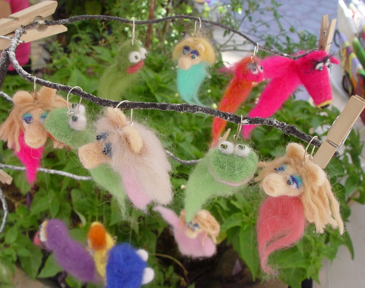 some earrings with figures from the muppet show