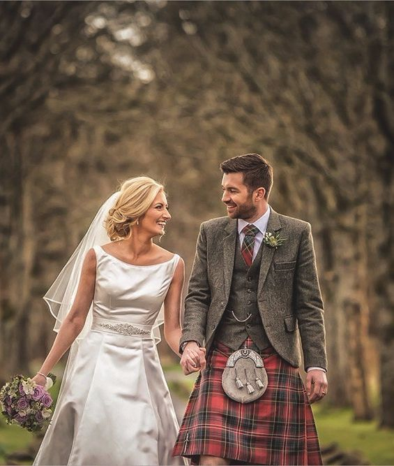 Grant and Maria were married at the picturesque Glen Bervie House in Larbert. Grant wore a Muted MacPherson tartan kilt with a Design Your Own jacket and waistcoat. His groomsmen wore our exclusive Glen Orchy Tweed jacket and waistcoat and Oban Mist kilt.
