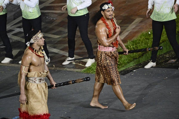 Athletes of American Samoa walk in the parade during the opening ceremony. The parade of nations featured most of the roughly 10,500 athletes — some planned to stay away to save their strength for competition — marching behind the flags of the 204 nations taking part.