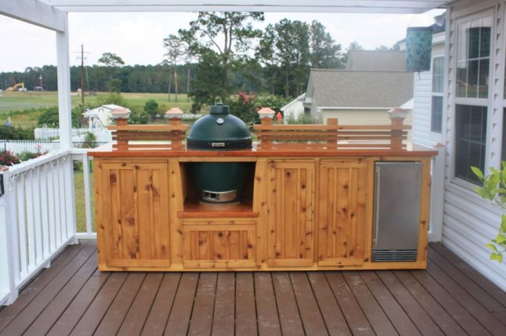 Astounding outdoor kitchen on wood deck with natural for Cedar outdoor kitchen cabinets