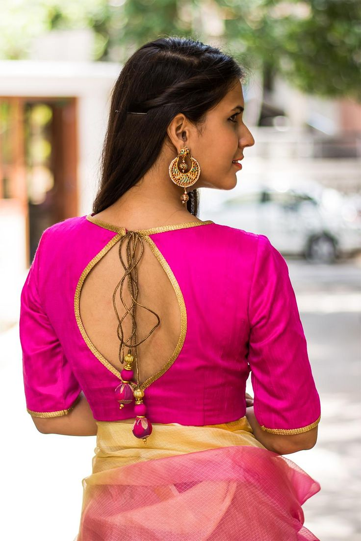 Ready to shop blouses | House Of Blouse. We think a fuchsia blouse is a must have in every blouse wardrobe. And talking about fuchsia blouses…this blouse is one cool number! High on style and detailing with a gold threadwork bib yoke edged with gold lace, having trendy elbow length sleeves.   Any contrast saree or a saree having a fuchsia pink border or print will do nicely. A fuchsia pink blouse is truly versatile and can be combined in a myriad ways!
