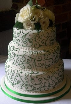 design work and roses make this cake. green ribbon looks cheap compared to the rest of the cake.