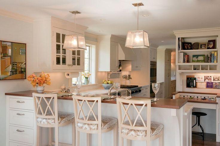 Барная стойка для кухни: материалы, особенности освещения и 75 элегантных интерьерных воплощений http://happymodern.ru/barnaya-stojka-dlya-kuxni-foto/ Консоль с ящиками, изготовленная из МДФ, является продолжением кухонной барной стойки