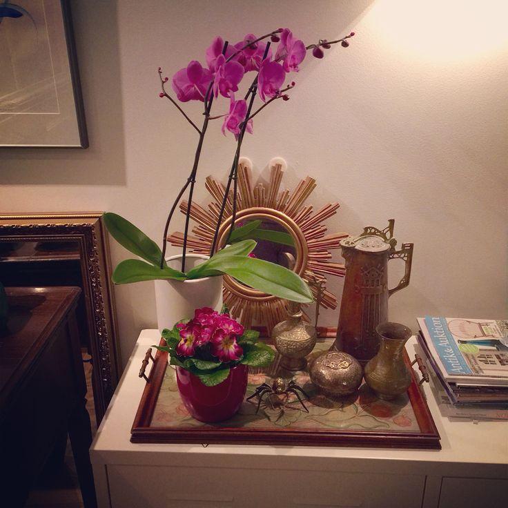 Flowers, sunburst mirror, bronze statue