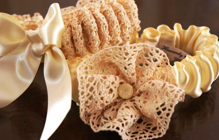 Main garter:  Champagne lace and satin with bow. Tossing garter:  Champagne satin with lace flower. louise@heavenlygarters.co.za