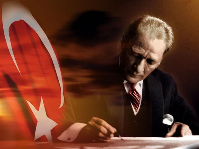 Turkish flag with an image of Mustafa Kemal Ataturk the founder of the Republic of Turkey and Turkey's greatest hero.