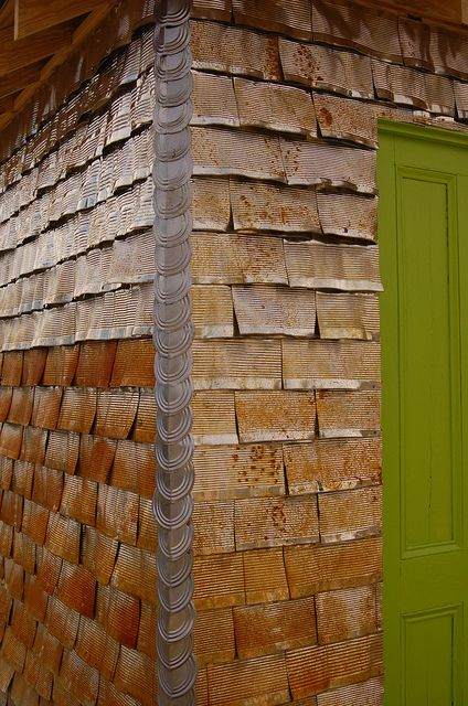 recycled tin can shed siding! Huh!? Cool look! Wonder how practical?? Chimborazo Park