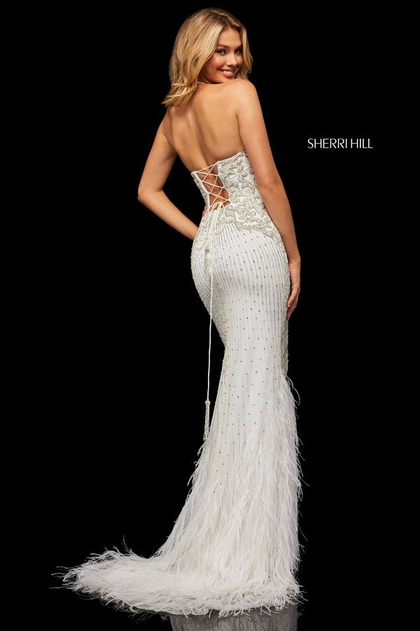 Fully Beaded Gown With A Halter Neck And Lace Up Back With Feather