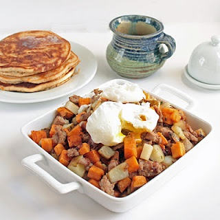 Sweet potato & sausage hash with perfect poached eggs.