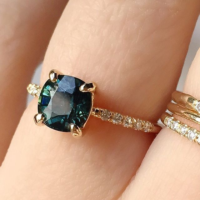 Vale Jewelry custom engagement ring featuring a Montana Sapphire and half pavé band