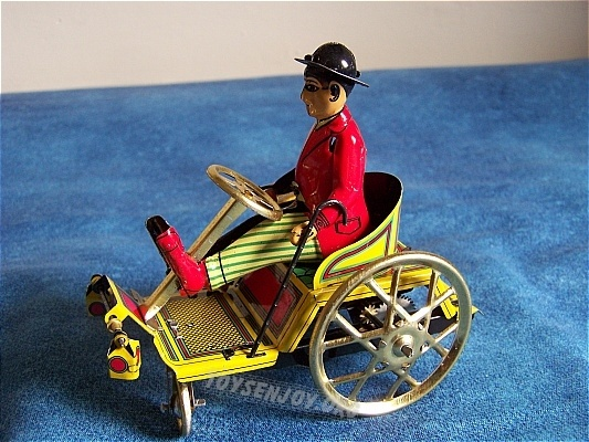just gorgeous! http://toysenjoy.net/images/tin%2520toy%2520wheel%2520chair%25202.jpg