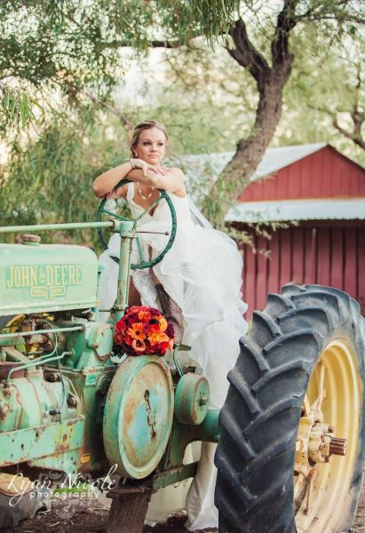 Stunning bride and Vintage John Deere, The Windmill Winery, AZ  I just love this shot!!!! Wish I had been creative.