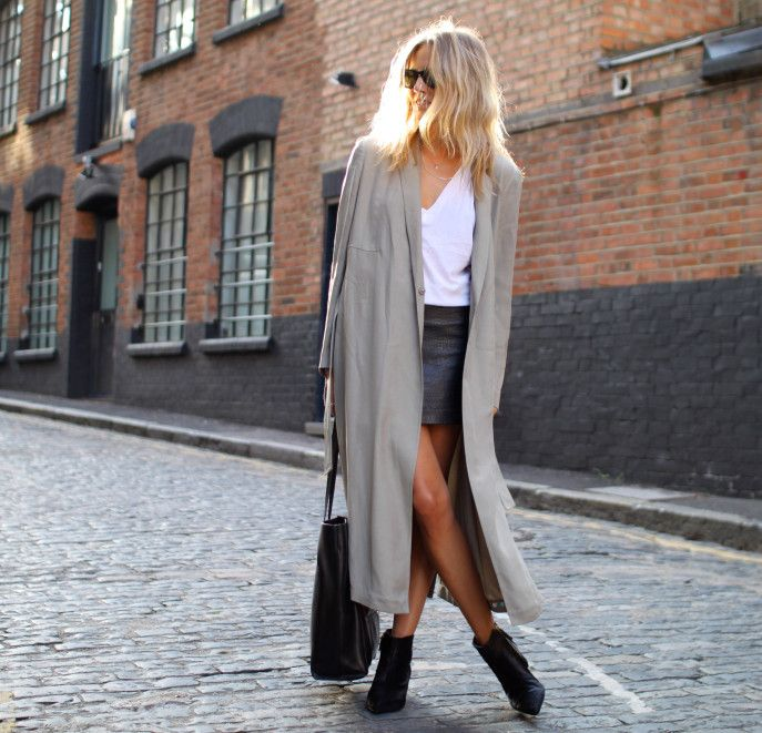trenching it. Lucy in London. #FashionMeNow Chic & edgy day look: leather mini, white top, ankle boots & long stone coloured trench.