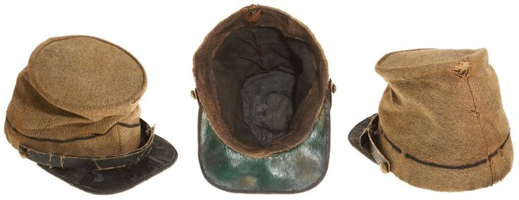 Ultra Rare Confederate Butternut Forage Cap. The black trim is in keeping with uniforms worn by Louisiana and North Carolina troops, although an exact state affiliation can not be determined.