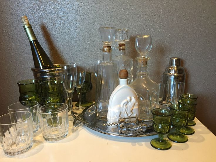 Equestrian style vintage wet bar set with 4 vintage decanters, and an assortment of eclectic vintage stemware & glassware   www.etsy.com/listing/452895156/the-equestrian-vintage-decanter