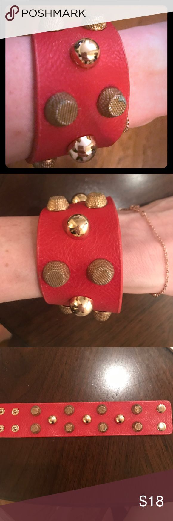 SALE studded leather bracelet Red leather studded bracelet. I believe I bought this at the GUESS Marciano Store in Mahattan a couple years ago. Guess by Marciano Jewelry Bracelets