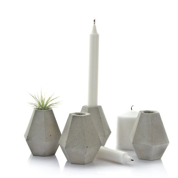 The concrete diamond candle holder features minimal lines and a raw texture. Its a sophisticated sculpture however when topped with a candle at dinner