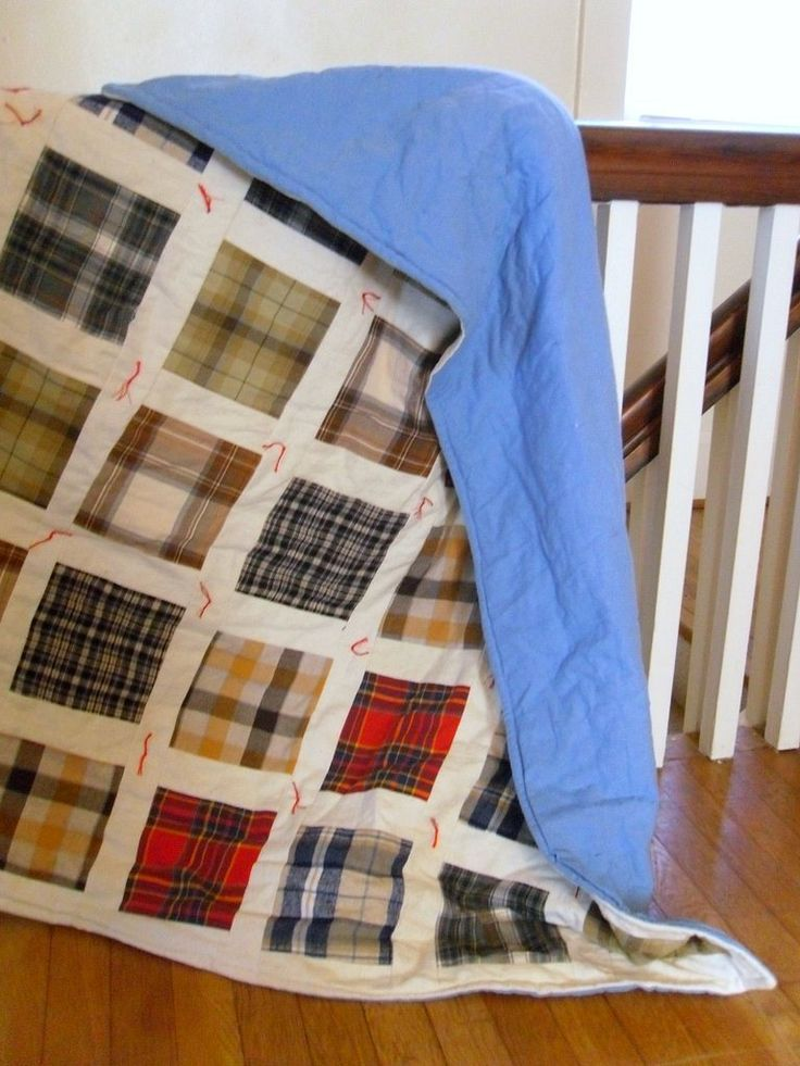 A more masculine style qult.  Good way to use up squares made from old shirts.  Wish had had some of my dads old shirts to make a quilt.  He always wore plaid.