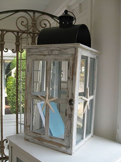 We have tons of these lanterns of all sizes... One might strike your fancy. And... It's a nice alternative to the bird cages that are EVERYWHERE.